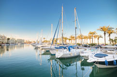 Scenic view of some Yachts in Marina port at dusk, in Benalmadena, Malaga, Spain. Stock Image