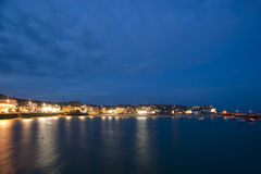Scenic view of St Ives, Cornwall at night. Scenic view of St Ives, Cornwall, UK at night with the lights reflected in the calm water of the bay under a twilight Stock Images