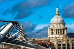 St Paul's cathedral and Millennium Bridge. Scenic view of St Paul's cathedral with Millennium Bridge in foreground, London, UK royalty free stock images