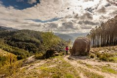 Scenic view of teenager watching at sunset mountains, Peneda-Geres National Park, northern Portugal stock image