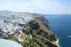 Scenic view of Thira in Santorin with white houses on mountain a Royalty Free Stock Images