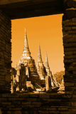 Scenic View The Three Ancient Buddhist Chedis of Wat Phra Si Sanphet in The Historic City of Ayutthaya Thailand through the Window Royalty Free Stock Image