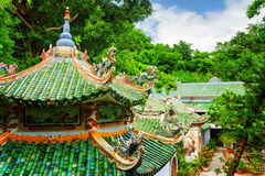 Scenic view of tile roofs of the Linh Ung Pagoda among woods Royalty Free Stock Photography