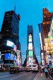 Scenic view of Times Square at night. New York City, USA - June 22, 2018: Scenic view of Times Square at night with a crowd of people, car traffic and LED Stock Photo