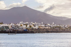 Scenic view to the promenade of Playa Blanca, Lanzarote from sea Royalty Free Stock Image
