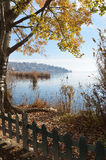 Scenic view of town and lake in autumn stock images