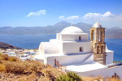 Scenic view of traditional greek cycladic church, village and se. Scenic view of traditional greek cycladic church and sea, Plaka village, Milos island, Greece stock photos
