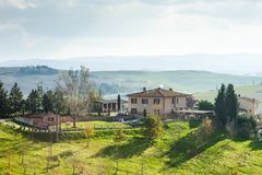 Scenic view of a tuscan farmhouse, Tuscany, Italy royalty free stock photos