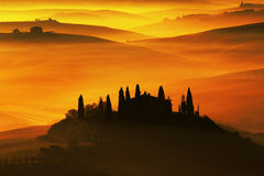 Scenic view of typical Tuscany landscape, house with hills during orange sunset, Italy Stock Image