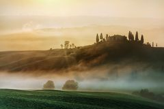 Scenic view of typical Tuscany mist landscape Stock Images
