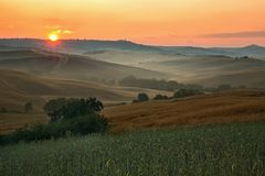 Scenic view of typical Tuscany mist landscape Stock Photography