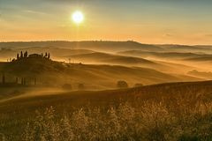 Scenic view of typical Tuscany mist landscape Stock Photo