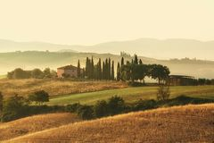 Scenic view of typical Tuscany mist landscape Stock Photos