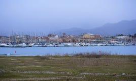 Scenic view of Viareggio town in Versilia land, Tuscany, Italy. Scenic view of Viareggio harbor, Tuscany, Italy,  on  a wintertime grey day royalty free stock image