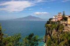 Landscape of Vico Equense. Scenic view of Vico Equense with the church of Santissima Annunziata on the cliff over the sea, mount Vesuvius on background, in stock photos