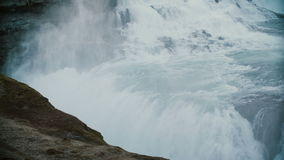 Scenic view of the water with splashes and foam. Beautiful landscape of the Gullfoss waterfall in Iceland. stock video footage