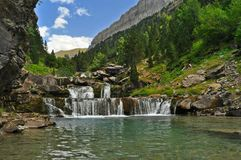 Scenic view on waterfall in the forest. On Spanish Pyrenees in Spain Royalty Free Stock Photo