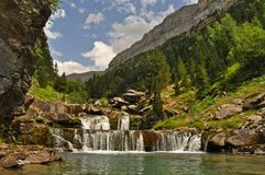 Scenic view on waterfall in the forest. On Spanish Pyrenees in Spain Royalty Free Stock Image