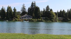 Scenic view of a waterfront house. Beautiful view of houses near a lake stock image