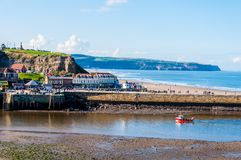 Scenic view of Whitby city and pier in sunny autumn day. Royalty Free Stock Photography