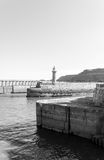 Scenic view of Whitby Lighthouse and Pier in sunny autumn day, UK Royalty Free Stock Image