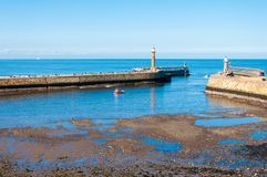 Scenic view of Whitby Pier in autumn sunny  day Stock Photo
