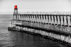 Scenic view of Whitby Pier in autumn sunny  day Royalty Free Stock Image