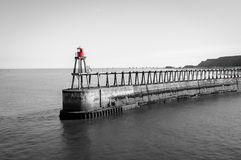 Scenic view of Whitby Pier in sunny autumn day in black and white.Whitby is a seaside town and port in North Yorkshire, UK. Its at Stock Image