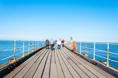 Scenic view of Whitby Pier in sunny autumn day Royalty Free Stock Photos