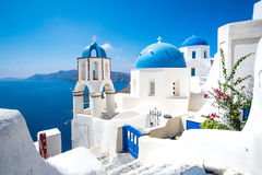 Scenic view of white houses and blue domes on Santorini Stock Images