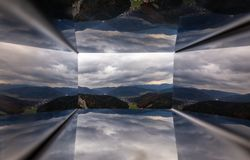 Scenic view through Wiener Alpen Viewer miror hole from top of Hausstein to green valley with colorful autumn forest. Scenic view through Wiener Alpen Viewer royalty free stock images
