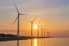 Scenic view of wind turbines stock photography