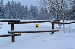 Scenic view of the winter landscape and an yellow bucket hanging on the railing. Harz mountains national park, Germany royalty free stock image