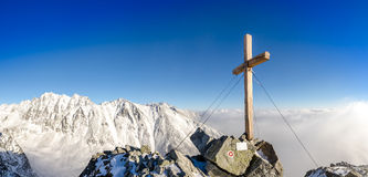 Scenic view of winter mountains peak with cross, High Tatras Stock Images