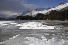 Scenic view of winter snow mountains landscape and frozen lake in the swiss Alps in Engadin Stock Photos