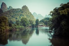 Scenic view of Yulong River among green woods and karst mountain. S at Yangshuo County of Guilin, China. Yangshuo is a popular tourist destination of Asia Stock Photos