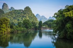 Scenic view of Yulong River among green woods and karst mountain. S at Yangshuo County of Guilin, China. Yangshuo is a popular tourist destination of Asia Royalty Free Stock Images
