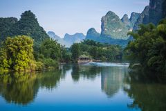 Scenic view of Yulong River among green woods and karst mountain. S at Yangshuo County of Guilin, China. Yangshuo is a popular tourist destination of Asia Royalty Free Stock Photo