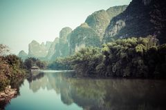 Scenic view of Yulong River among green woods and karst mountain. S at Yangshuo County of Guilin, China. Yangshuo is a popular tourist destination of Asia Stock Images