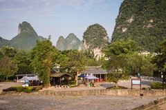 Scenic view of Yulong River among green woods and karst mountain. S at Yangshuo County of Guilin, China. Yangshuo is a popular tourist destination of Asia Stock Image