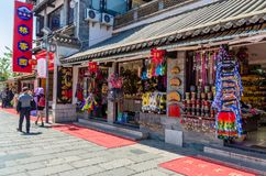 Scenic view of the Yunnan Nationalities Village which is located at Kunming Yunnan, people can be seen exploring around it. Royalty Free Stock Images