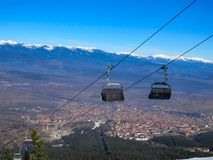 Scenic views of the cable car over a large European city in the mountains royalty free stock photo