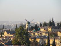 Scenic views of Jerusalem`s neighborhoods and the windmill at dawn. royalty free stock images