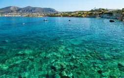 Free Scenic Views Of The Seabed With Green Stones, A City On The Shore And A Small Boat In Bay Of Island Crete, Greece. Stock Images - 94403124