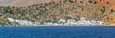 Scenic village of Loutro and the mediterranean sea  in Crete Greece. Scenic village of Loutro and the mediterranean sea  in Crete, Greece Stock Photo