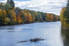 Scenic vista on the Farmington River in Canton, Connecticut. Long view of fall foliage on the Farmington River in the Collinsville section of Canton Stock Image