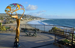 Scenic walkway viewing area with art work in Heisler Park, Laguna Beach, California. Image shows a scenic walkway overlooking the Main Beach in picturesque royalty free stock photography