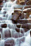 Scenic waterfall. With water flowing over rocks Stock Photography