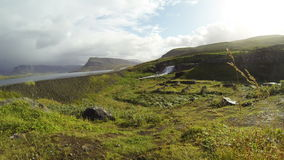 Scenic waterfall. Beautiful waterfall by the roadside in Iceland stock video