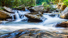 Scenic waterfall flowing on stone, North Thailand Royalty Free Stock Image